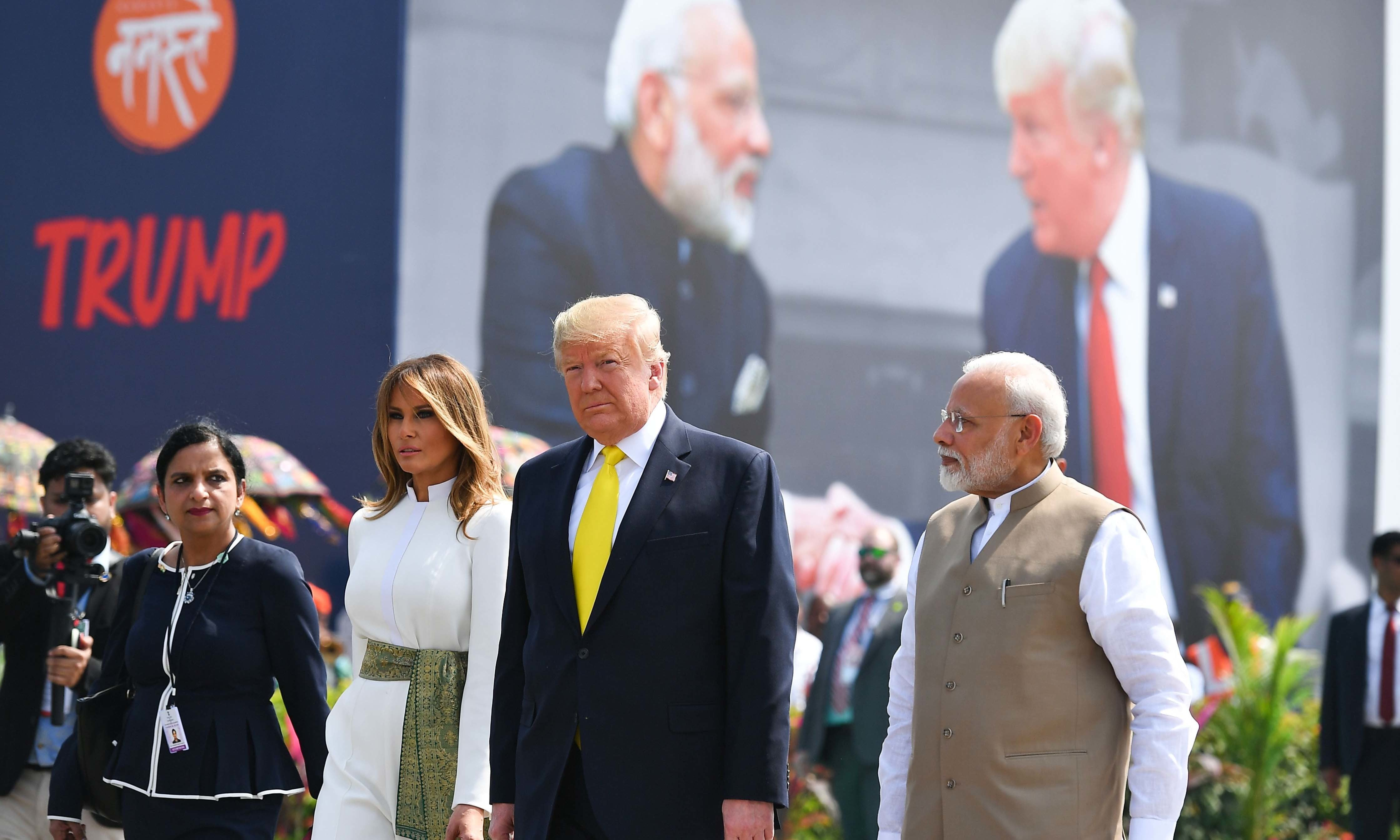 India's Prime Minister Narendra Modi (R) greet US President Donald Trump (C) and First Lady Melania Trump (2L) upon their arrival at Sardar Vallabhbhai Patel International Airport in Ahmedabad on February 24, 2020. — AFP