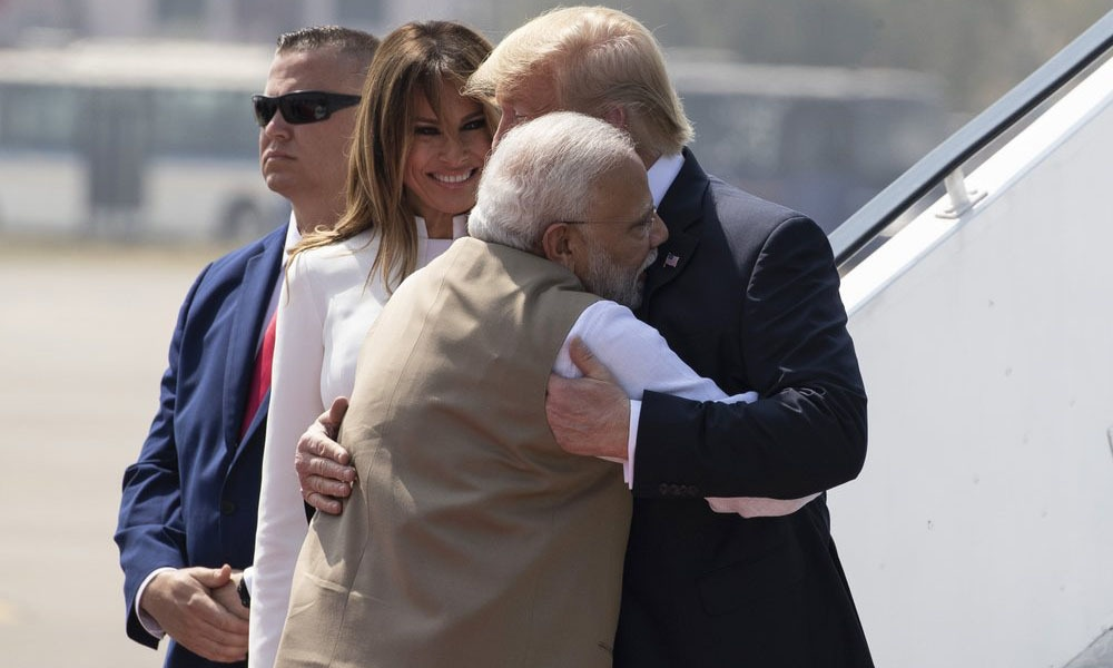 US President Donald Trump is greeted by Indian Prime Minister Narendra Modi, with first lady Melania Trump, as they step off Air Force One upon arrival at Sardar Vallabhbhai Patel International Airport, on Feb 24 in Ahmedabad, India. — AP