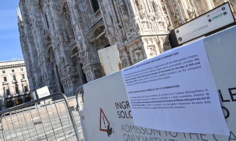 A picture taken on Monday shows a message explaining the closure of the Duomo, in central Milan,  following security measures taken in northern Italy against COVID-19. — AFP