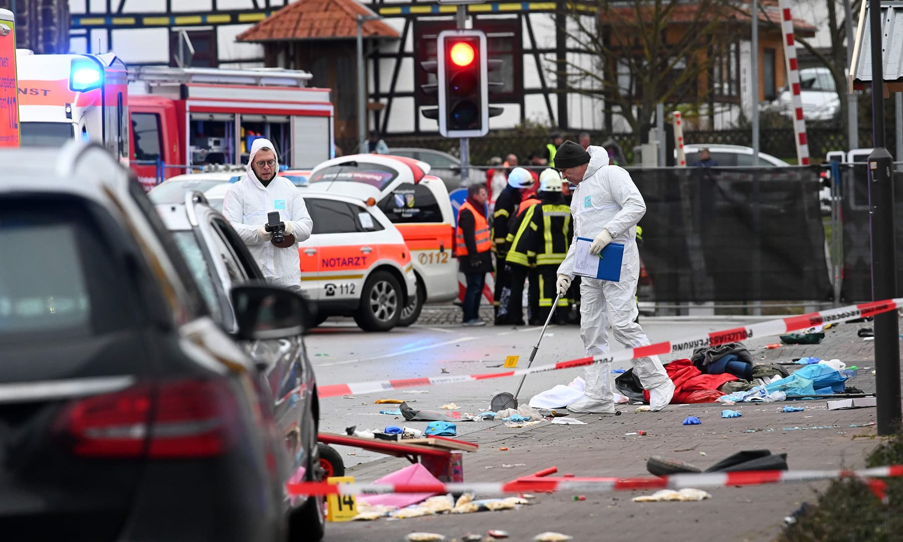 Forensic police officers are seen close to the site where a car drove into a carnival procession in Volkmarsen near Kasse on Feb 24. — Monday