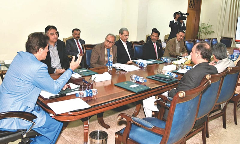 ISLAMABAD: Prime Minister Imran Khan chairs a meeting on possible ways to stabilise electricity price at PM Office on Monday.—PPI