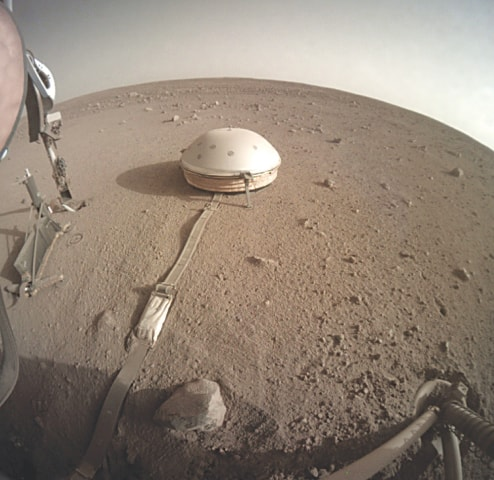 The InSight lander's dome-covered seismometer on Mars.—AP