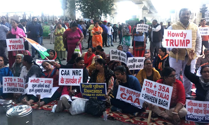 A group of CAA supporters sitting on the road near Maujpur Chowk.