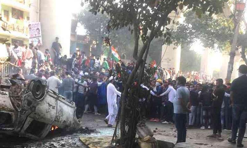 One of the vehicles burnt near Maujpur Chowk.