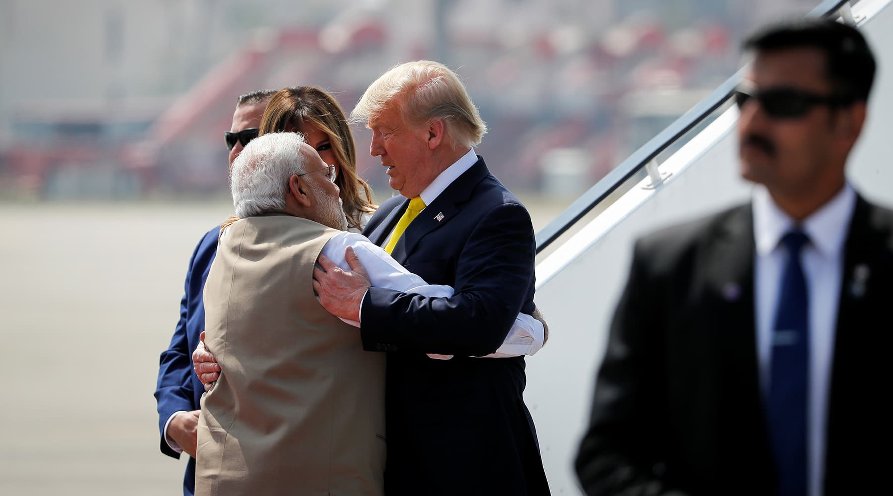 US President Donald Trump greets Indian Prime Minister Narendra Modi as he arrives at Sardar Vallabhbhai Patel International airport in Ahmedabad, India on February 24. — Reuters