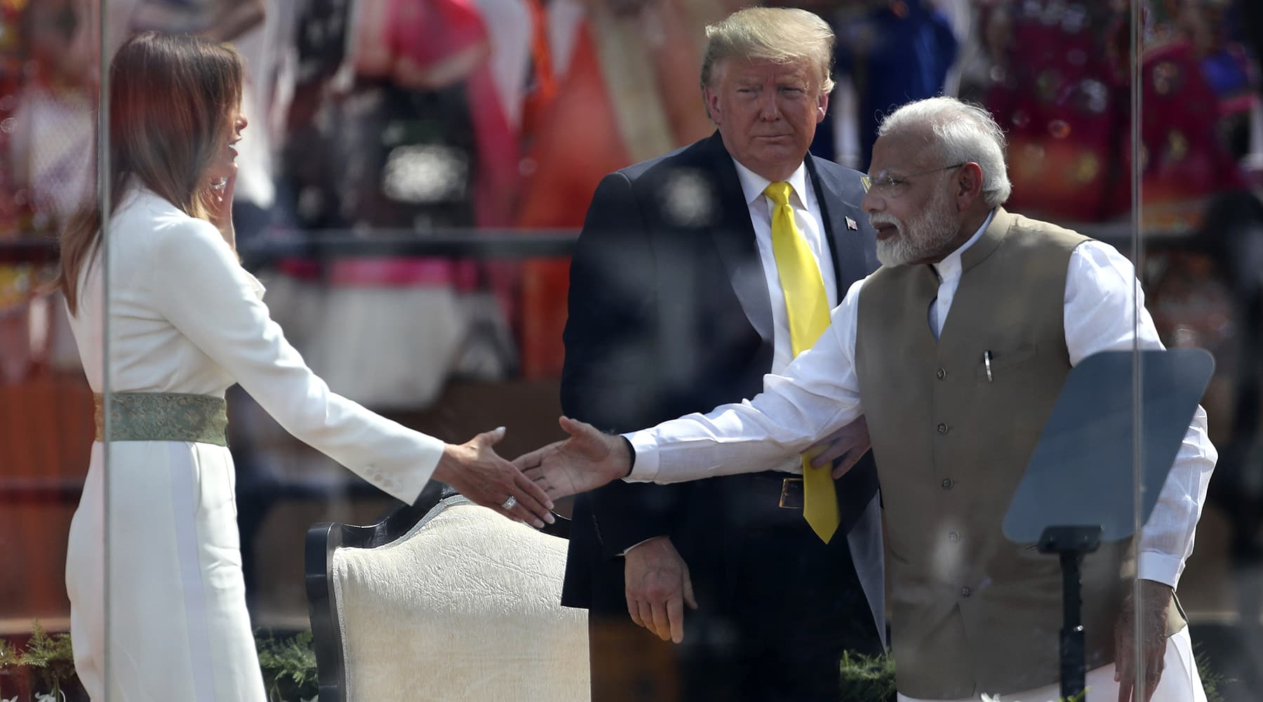 US President Donald Trump, centre, watches as first lady Melania Trump, left, shakes hands with Indian Prime Minister Narendra Modi during the 'Namaste Trump' event at Sardar Patel Stadium in Ahmedabad, India on Feb 24.  — AP