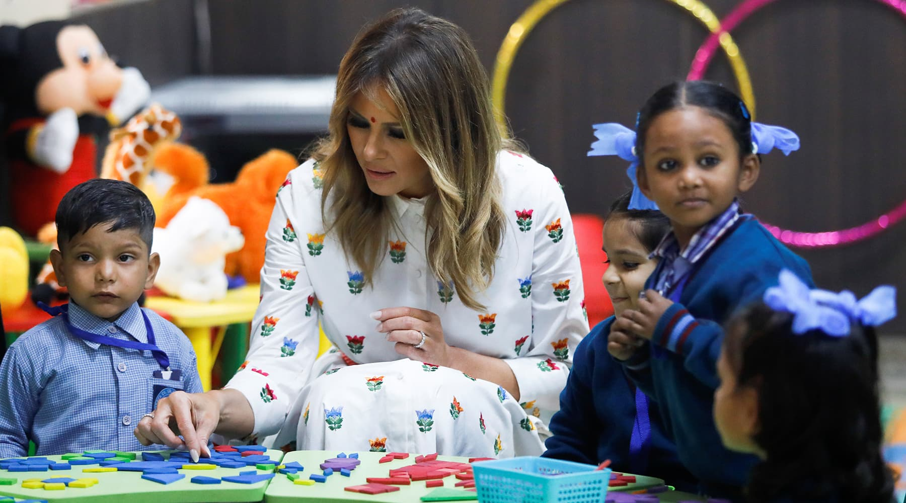 US first lady Melania Trump plays with children at the Sarvodaya Co-Education Senior Secondary School in Moti Bagh in New Delhi, February 25. — Reuters