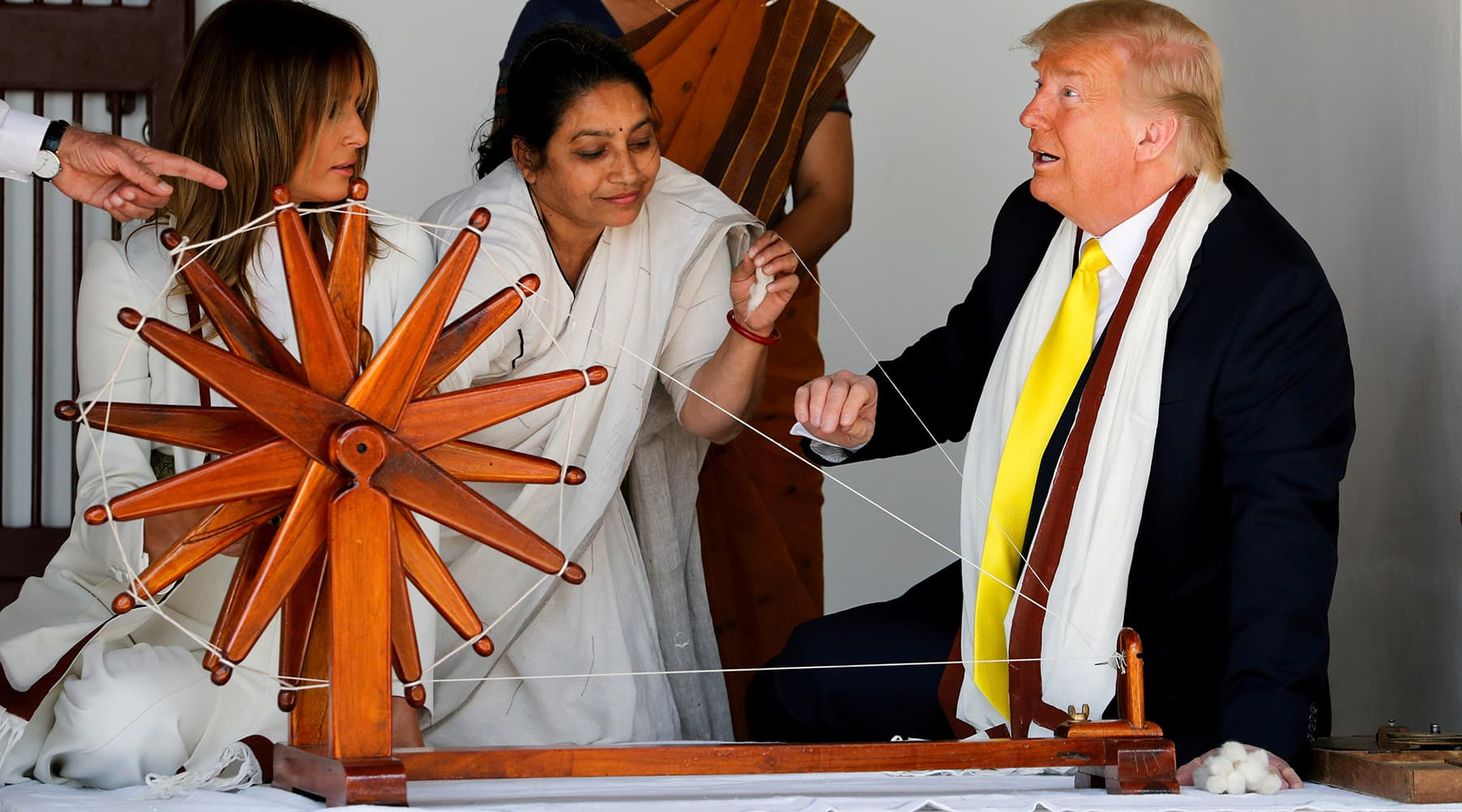 Women show how a Charkha, a type of Indian spinning wheel, works to US President Donald Trump and first lady Melania Trump, as they visit the Gandhi Ashram in Ahmedabad, India, February 24. — Reuters