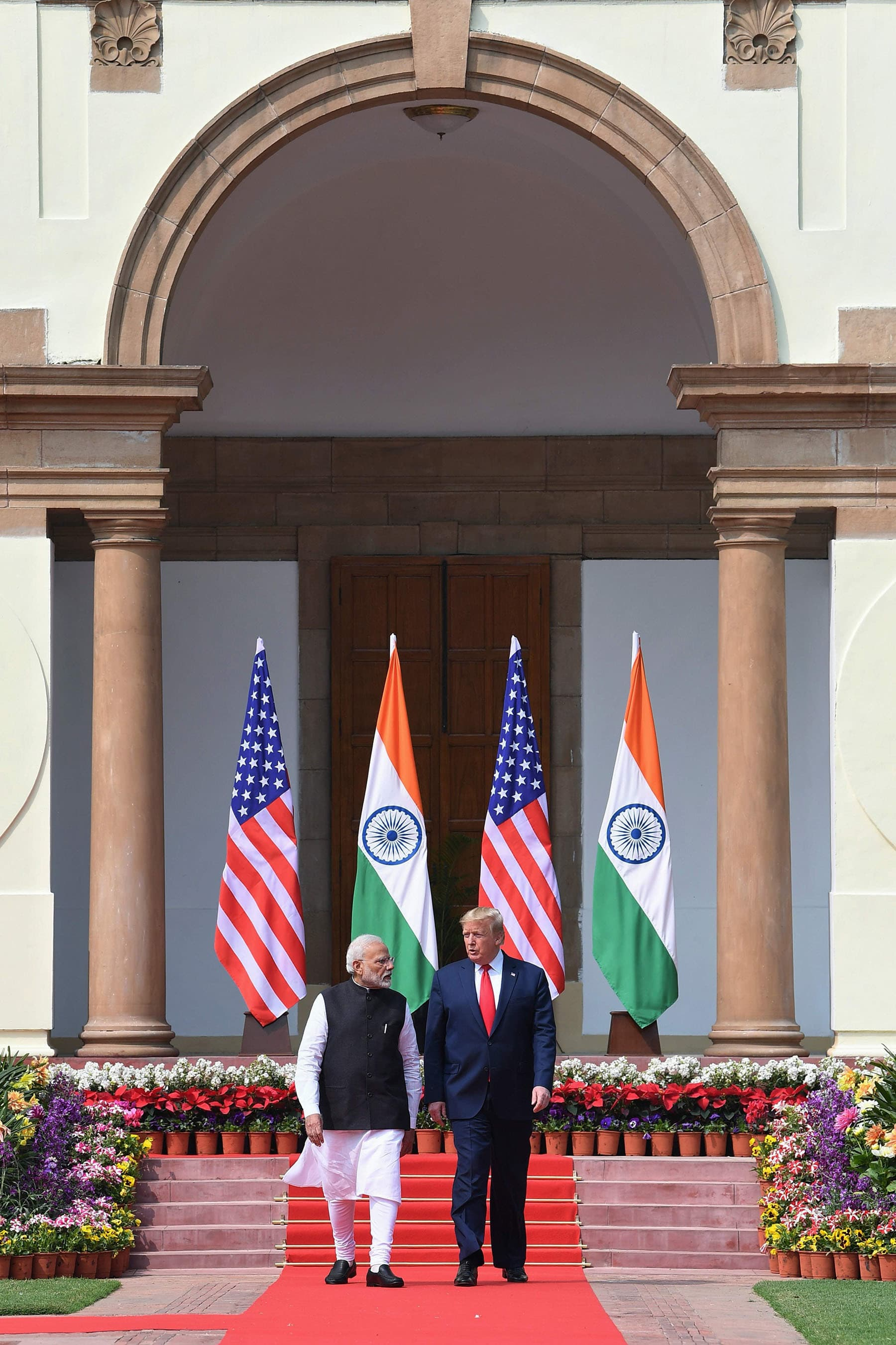 US President Donald Trump (R) and India's Prime Minister Narendra Modi arrive for a joint press conference at Hyderabad House in New Delhi.  — AFP PHOTO/MEA