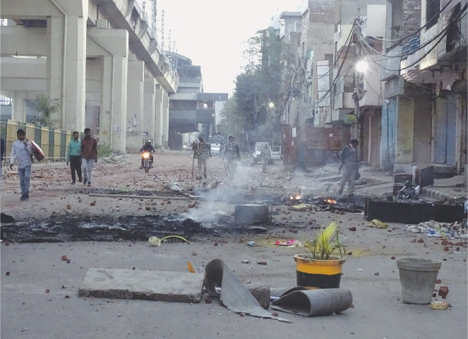NEW DELHI: A vandalised street seen after violence between two groups on Tuesday.—AP