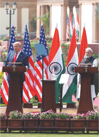 PRESIDENT Donald Trump and Prime Minister Narendra Modi attend a joint news conference in the Indian capital.—Reuters