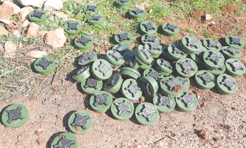 IDLIB: Defused Russian anti-personnel mines seen in a village near Idlib, north-western Syria, after Turkey-backed rebels seized the village from pro-Assad forces.—AFP