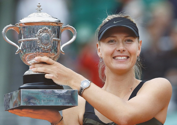 IN this June 9, 2012 file photo, Russia's Maria Sharapova holds the French Open winner's trophy after defeating Sara Errani of Italy in the final at Roland Garros.—AFP