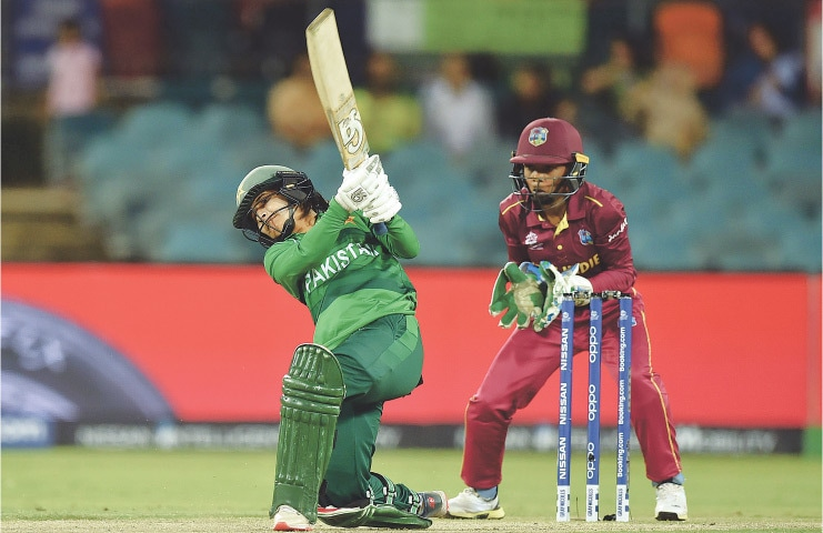 CANBERRA: Pakistan opener Javeria Khan plays a shot as West Indies wicket-keeper Shemaine Campbelle looks on during their ICC Twenty20 World Cup match at the Manuka Oval on Wednesday.—AFP