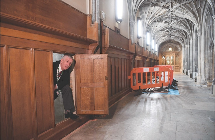LONDON: Lindsay Hoyle, speaker of the House of Commons, poses near a secret chamber concealing the 360-year-old blocked passageway rediscovered during renovation work in the Houses of Parliament.—AFP