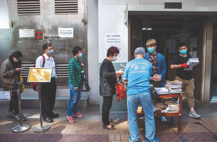 Hong Kong to give big cash handouts to jumpstart economy