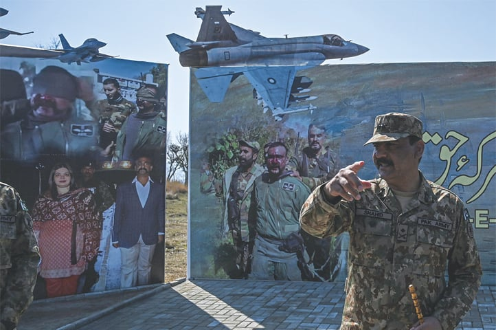 Brigadier Shahid gives briefing to an international media team at Horran village on Wednesday.—AFP