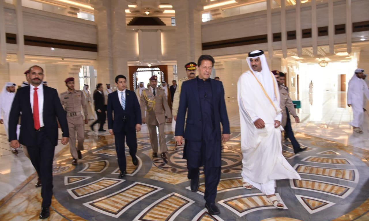 Prime Minister Imran Khan seen alongside Qatar's Emir Sheikh Tamim Bin Hammad Al-Thani in Doha on Thursday.  — Photo courtesy Sanaullah Khan
