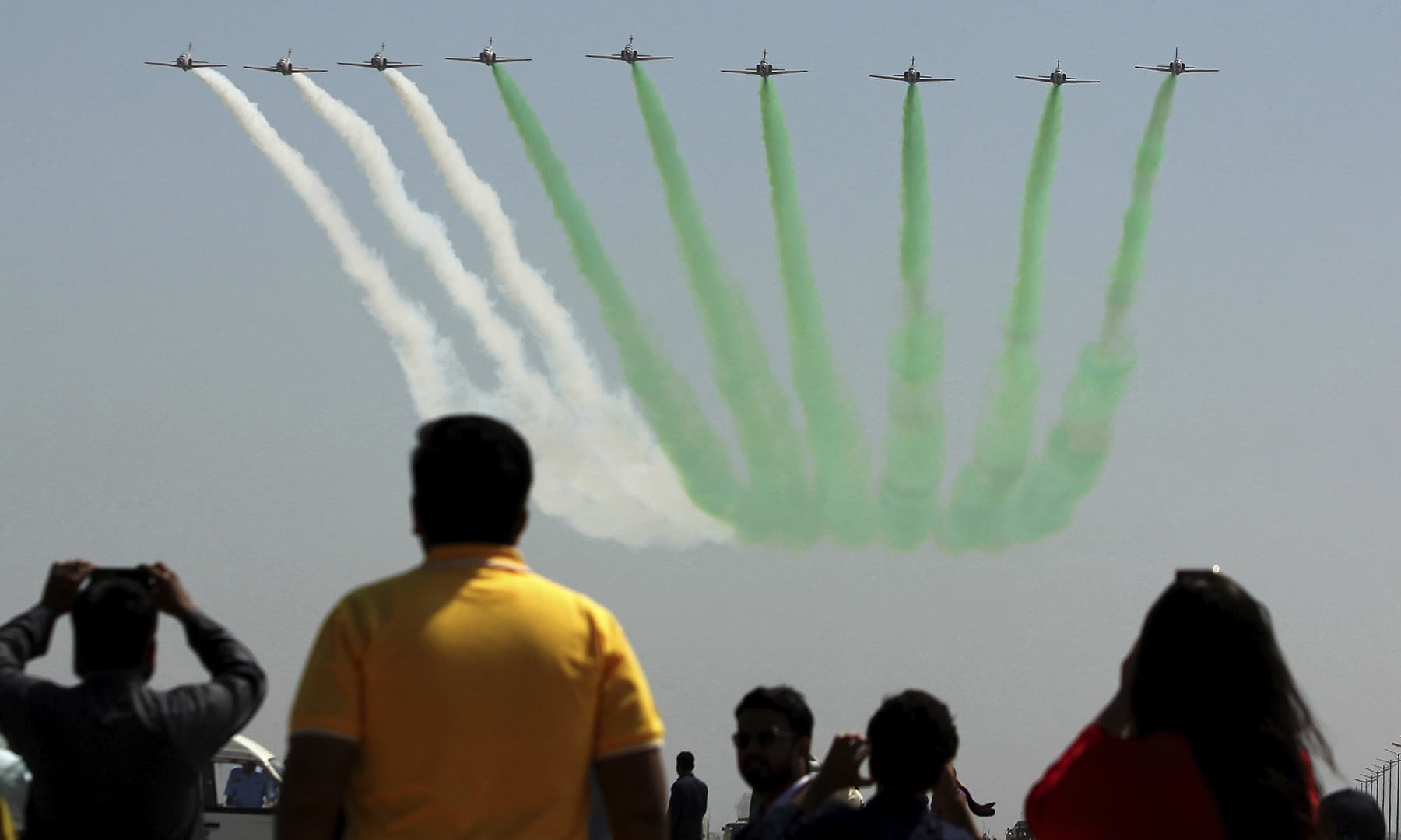 PAF fighter jets perform an aerobatic show to mark the first anniversary of 'Operation Swift Retort' in Karachi. — AP