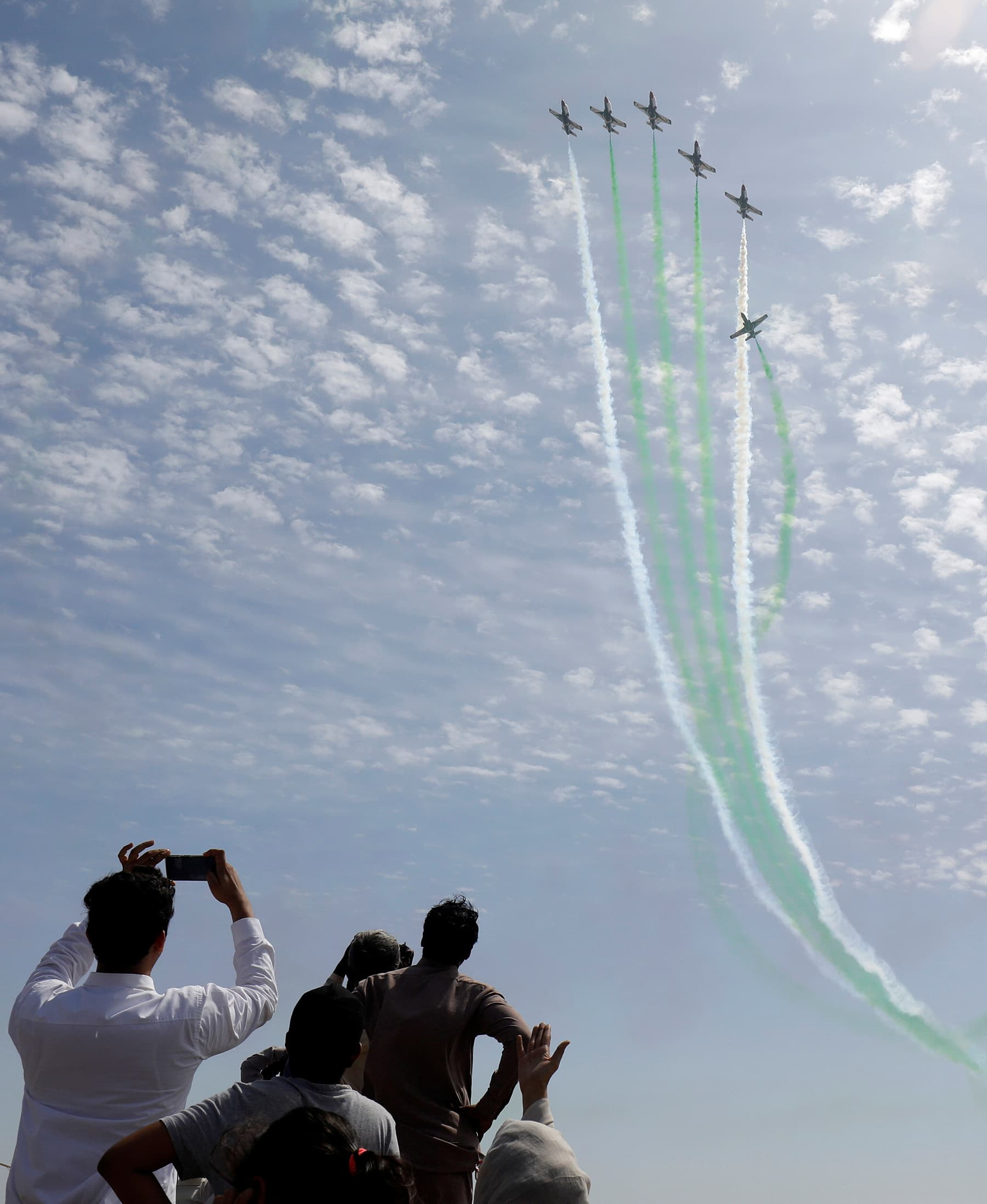 People take photos as PAF jets perform. — Reuters