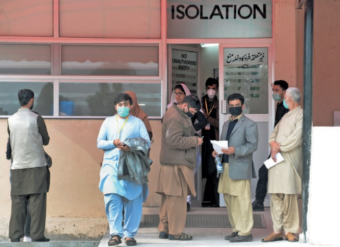 Citizens stand outside the isolation ward of Pims to get themselves checked for coronavirus on Thursday. — Photo by Mohammad Asim