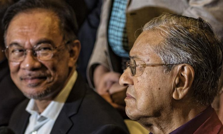Both Mahathir and Anwar are vying for the premiership, reviving their two decades-old political feud. — Reuters