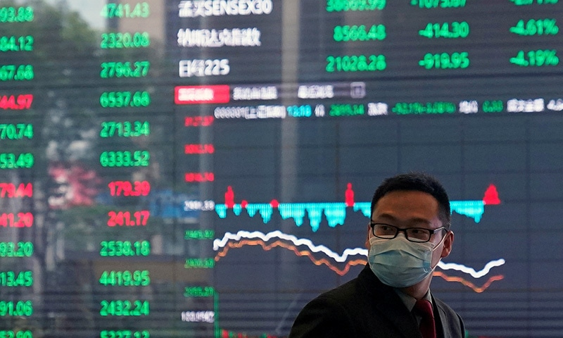 A man wearing a protective mask is seen inside the Shanghai Stock Exchange building, as the country is hit by a new coronavirus outbreak, at the Pudong financial district in Shanghai, China on February 28. — Reuters