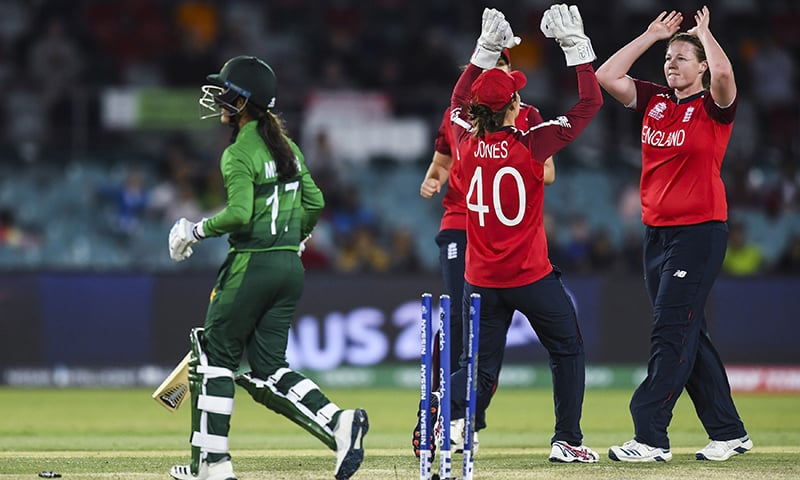 England's Anya Shrubsole, pictured right, celebrates with teammates after claiming the wicket of Muneeba Ali Siddiqui of Pakistan during their Women's T20 World Cup match in Canberra, Australia on Friday. — AP
