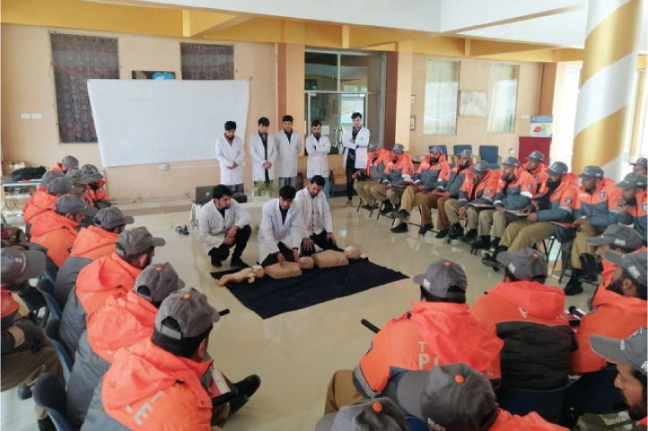 The tourist police personnel attend a first aid training session in Gilgit on Friday. — Dawn