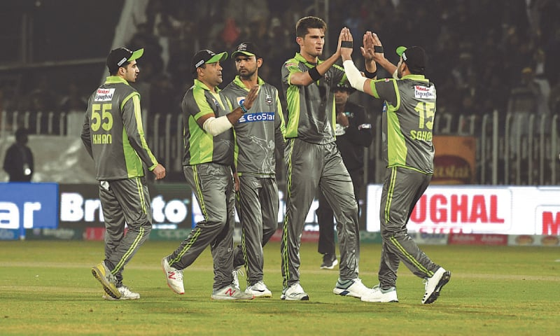 LAHORE Qalandars celebrate the dismissal of a batsman. —Tanveer Shahzad/White Star