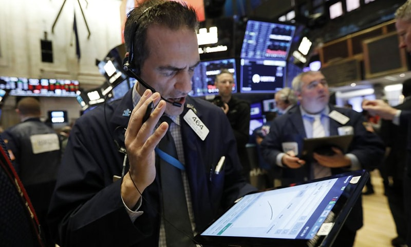 Trader Gregory Rowe works on the floor of the New York Stock Exchange on Friday.  Stocks are opening sharply lower on Wall Street, putting the market on track for its worst week since October 2008 during the global financial crisis. — AP