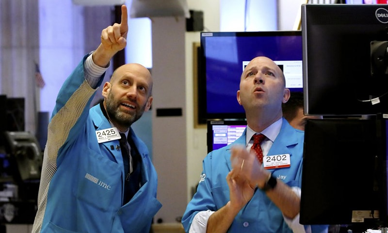 Specialists Meric Greenbaum, left, and Jay Woods work on the floor of the New York Stock Exchange on Friday. Stocks are opening sharply lower on Wall Street, putting the market on track for its worst week since October 2008 during the global financial crisis. — AP
