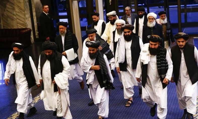 Members of the Taliban delegation arrive at the venue of the deal signing. — Anadolu Agency