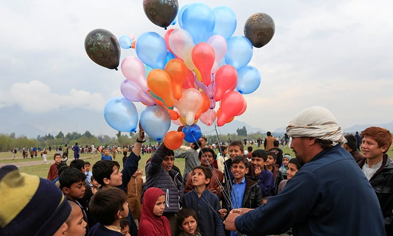 Afghan children buy balloons as they celebrate in anticipation of the US-Taliban agreement to allow a US troop reduction and a permanent ceasefire, in Jalalabad, Afghanistan, February 28. — Reuters