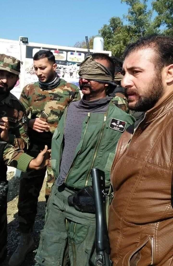 The captured Indian pilot, Abhinandan Varthaman, with Pakistan Army men | File photo