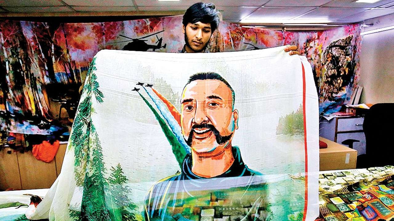A tapestry featuring Indian Wing Commander Abhinandan's portrait is sold in India | Reuters image