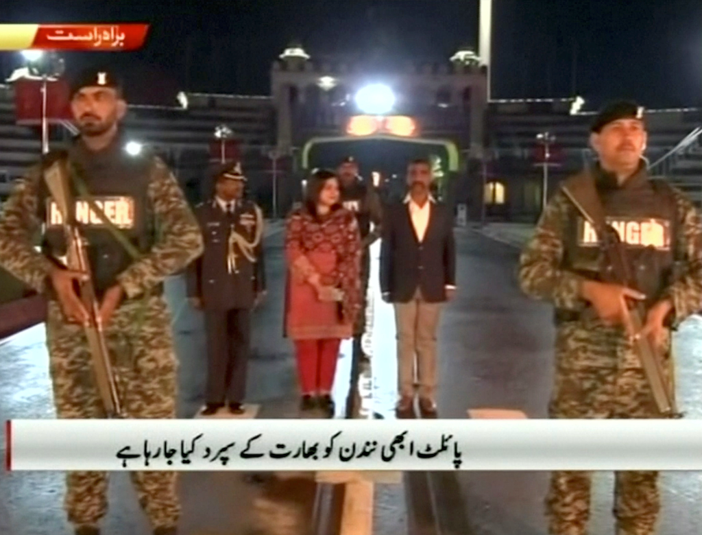 Indian pilot Abhinandan stands with armed escort at the Wagah border on March 1, 2019 | Screengrab