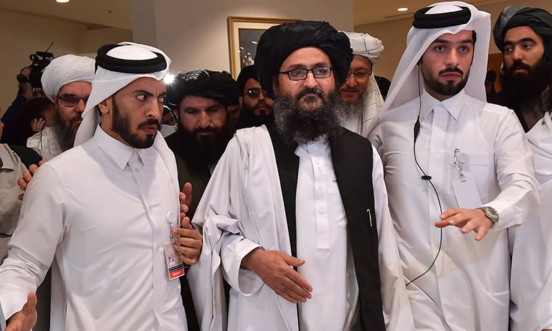 Taliban co-founder Mullah Abdul Ghani Baradar leaves after signing an agreement with the US during a ceremony in the Qatari capital Doha on February 29. — AFP