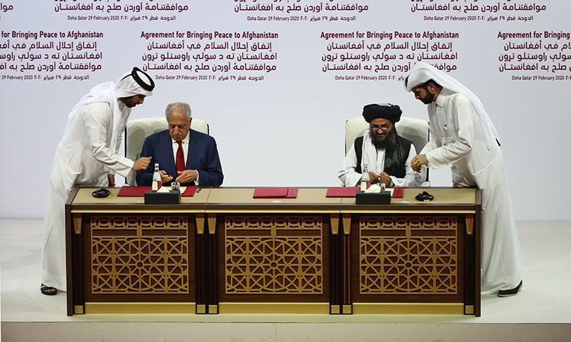 (L to R) US Special Representative for Afghanistan Reconciliation Zalmay Khalilzad and Taliban co-founder Mullah Abdul Ghani Baradar sign a peace agreement during a ceremony in the Qatari capital Doha on February 29. — AFP
