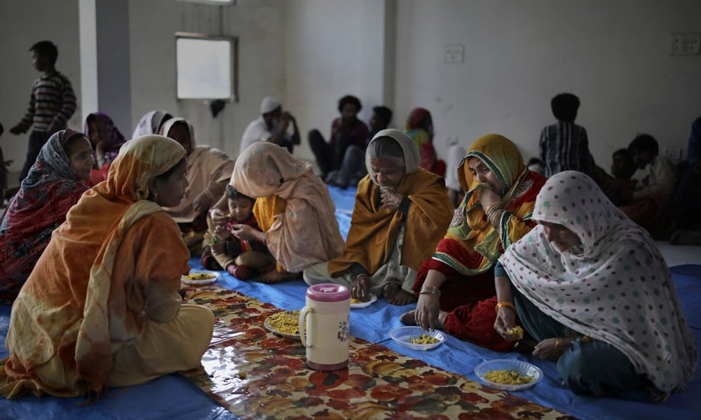 Muslim women, who were rescued after their homes were attacked by a marauding Hindu mob, sob while eating a meal inside a hall which doubles as a shelter at Al-Hind hospital in Old Mustafabad neighbourhood of New Delhi, India on Friday. Delhi's worst communal violence in decades has left at least 42 people dead and hundreds injured. — AP