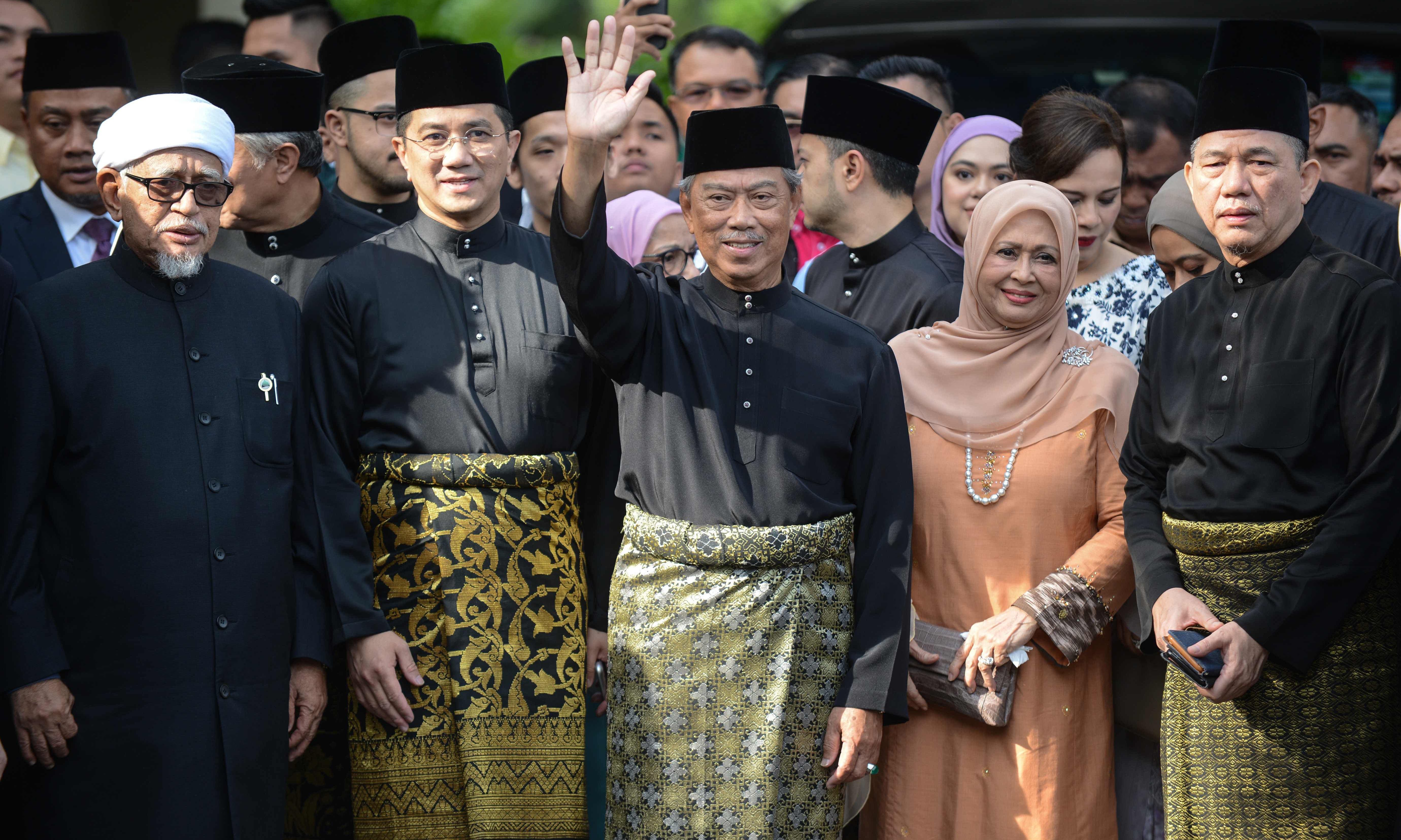 Malaysia's incoming prime minister Muhyiddin Yassin (centre) waving outside his residence in Kuala Lumpur before his swearing-in ceremony as the country's new leader. — Photo courtesy handout from Malaysia's Department of Information/AFP.