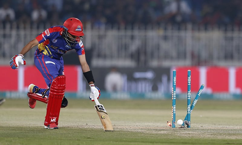 Karachi Kings batsman Babar Azam tries to save his run out by Shadab Khan of Islamabad United during their Pakistan Super League T20 cricket match in Rawalpindi, Sunday, March 1. — AP