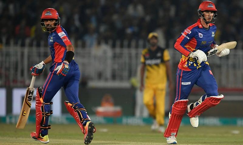 Karachi Kings' Alex Hales (R) and Babar Azam take a run during the Pakistan Super League (PSL) T20 cricket match at the Rawalpindi Cricket Stadium on March 2. — AFP