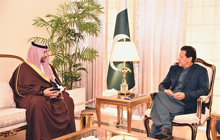 ISLAMABAD: Prime Minister Imran Khan exchanges views with Saudi Arabia's Deputy Defence Minister Prince Khalid bin Salman bin Abdulaziz during a meeting at PM House on Monday.—PPI