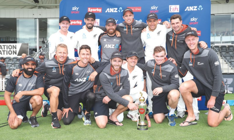 NEW ZEALAND players pose with the series trophy on Monday.—Reuters