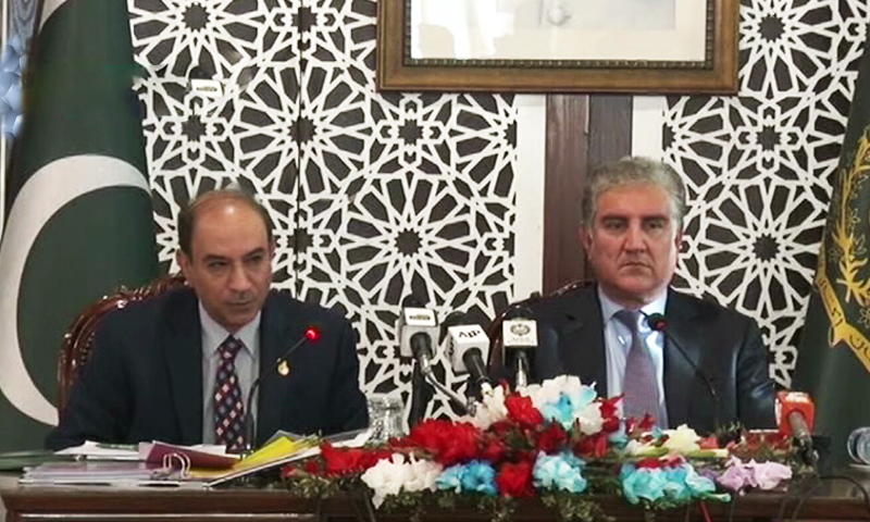 Organisation of Islamic Cooperation secretary general's Special Envoy for Jammu and Kashmir Ambassador Yousef M. Al Dobeay addresses a media conference with Foreign Minister Shah Mehmood Qureshi in Islamabad on Tuesday. — DawnNewsTV