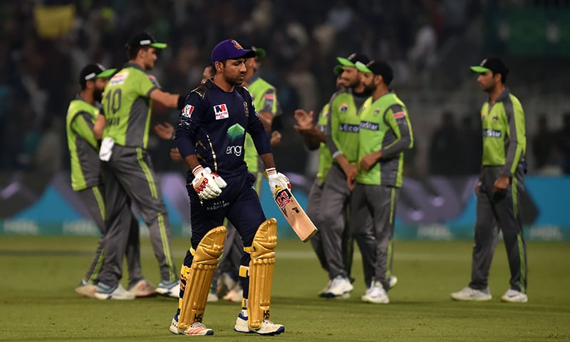 Quetta Gladiators' captain Sarfraz Ahmed (front) walks off after his dismissal during the Pakistan Super League (PSL) T20 cricket match against Lahore Qalandars at the Gaddafi Cricket Stadium in Lahore on March 3. — AFP
