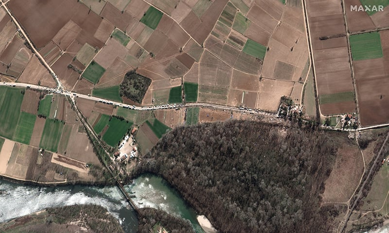 An aerial view shows refugees on road at Turkey's Pazarkule border crossing with Greece's Kastanies, southwest of Edirne, Turkey on March 3. — Satellite image ©2020 Maxar Technologies/Handout via Reuters