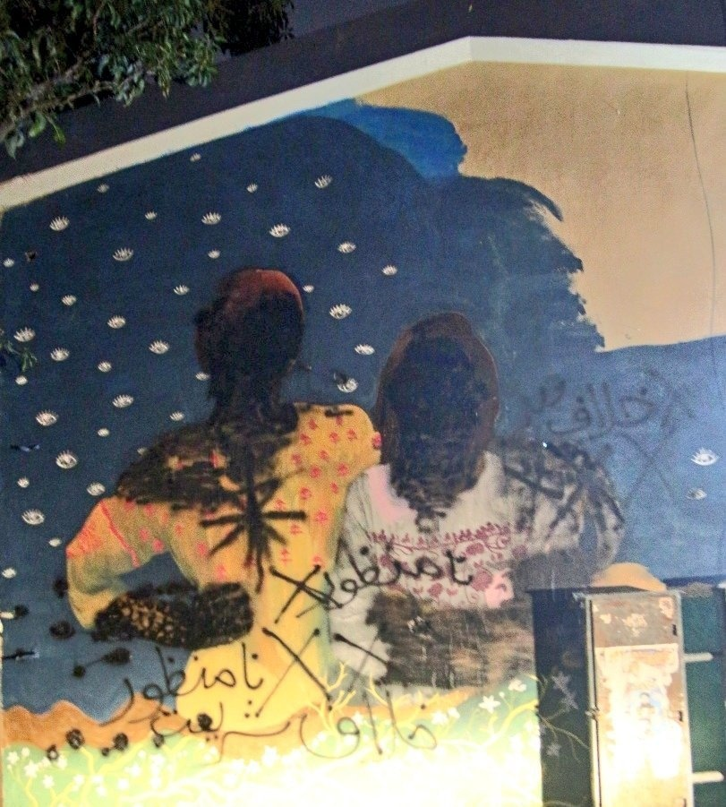 Faces on the mural were blackened in the middle of the night— *Twitter*