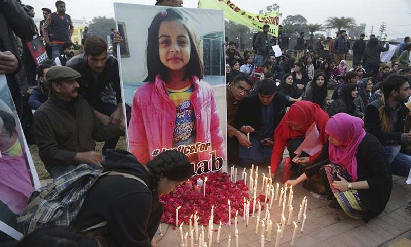 Students light candles during a protest rally to condemn the rape and killing of Zainab Ansari, an 8-year-old girl, in Kasur, Jan 11, 2018, in Lahore. — AP/File